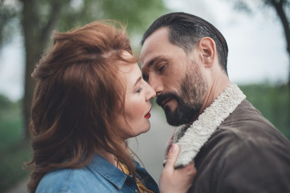 Tender Man And Woman Kissing In The Park