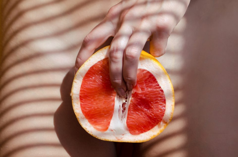 A Woman Is Holding A Grapefruit By Her Body Concept Masturbation